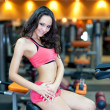 Girl with perfect body in fitness hall — Stock Photo #4020543