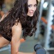 Girl with perfect body in fitness hall — Stock Photo #4020546