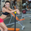 Girl with perfect body in fitness hall — Stock Photo