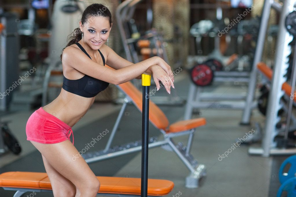 Sporty Girl in fitness hall, healthy concept — Stock Photo #4020550