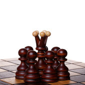 Queen and pawns — Stock Photo