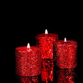 Three spangled candles in the dark — Stock Photo