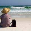 Woman Sitting On Beach With Bag — Stock Photo
