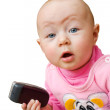 Surprised baby with cell phone, isolated — Stock Photo