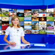 Television anchorwoman at TV studio — Stock Photo #4419129