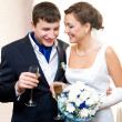 Bridegroom and bride with champagne - Stock Photo