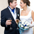 Bridegroom and bride with champagne — Stock Photo