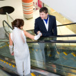 Bridegroom and bride on escalator — Stock fotografie