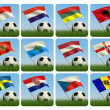 Soccer ball in the grass and the flag against the blue sky. - Stock Photo