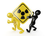 Two men with simbol of radiation — Stock Photo