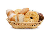 Basket of various fresh baked bread — Stock Photo