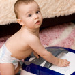 Cute caucasian baby with vacuum cleaner — Stock Photo