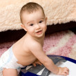 Cute caucasian baby with vacuum cleaner — Stock Photo #4845497