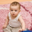Cute caucasian baby with vacuum cleaner — Stock Photo #4845507