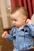Cute caucasian baby in blue shirt — Stock Photo