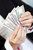 Woman hands holding money us dollars. — Stock Photo