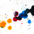 Colorful ink blot on white - Stock Photo