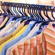 mix color shirt and tie on hangers — Stock Photo
