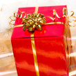 Red gift box on golden background — Stock Photo #3950970