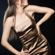 Elegant fashionable woman in golden dress — Stock Photo