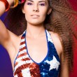 American woman in colored background - Stock Photo