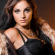 Beautiful fashionable woman with fur — Stockfoto #3978710