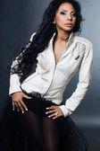 Sexy fashionable mulatto woman on black background — Stock Photo