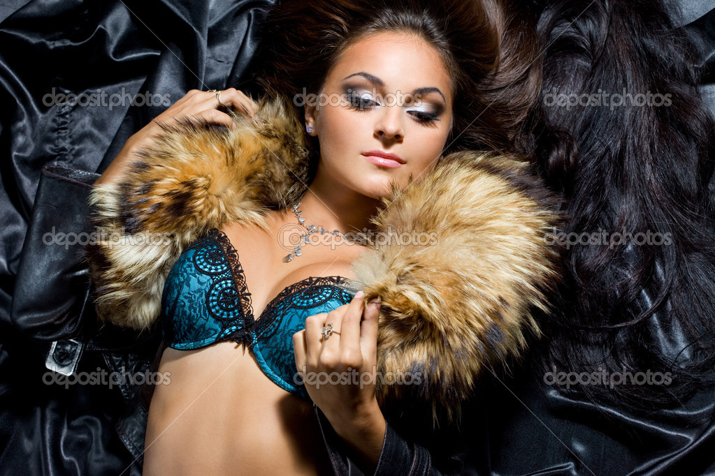 Beautiful fashionable woman with fur  Stock Photo #3978700