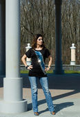 Beautiful woman near the column — Stock Photo