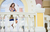 Beautiful woman near the balcony — Stock Photo