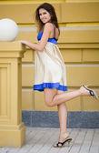 Beautiful woman near the stairs — Stock Photo