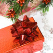 Red gift box with Christmas tree — Stock Photo