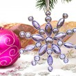 Violet candle with Christmas star — Stock Photo #4171218