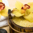 Spa essentials (salt for bath, white towel and orchids) — Stock Photo