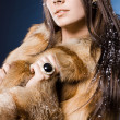 Stock Photo: Beautiful womin fur coat
