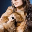 Beautiful womin fur coat — Stock Photo #4171634