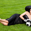 Stock Photo: Elegant woman with Football ball