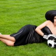 Elegant woman with Football ball - ストック写真