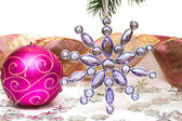 Violet candle with Christmas star — Stok fotoğraf