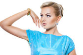 Beautiful fashionable woman in a dress — Stock Photo