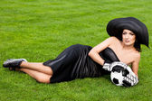 Elegant woman with Football ball — Stock Photo