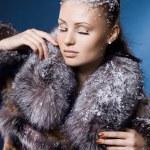 Beautiful woman in a fur coat — Stock Photo #4265690