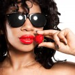 Mulatto girl with fresh strawberry - Stock Photo