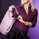 Beautiful fashionable woman with handbag — Stock Photo