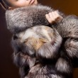 Beautiful woman in a fur coat — Stock Photo