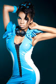 Mulatto girl DJ listens music with headphones — Stock Photo