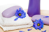 Spa essentials, soap and towel with blue flowers — Stock Photo