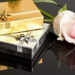 Gift boxes with rose on black background - Stockfoto