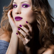 Stock Photo: Elegant fashionable womwith violet visage