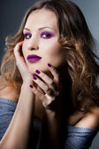 Elegant fashionable woman with violet visage — Stock Photo